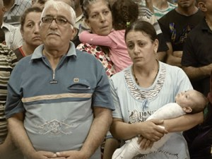 Displaced Iraqi Christians attending a worship service in northern Kurdistan.